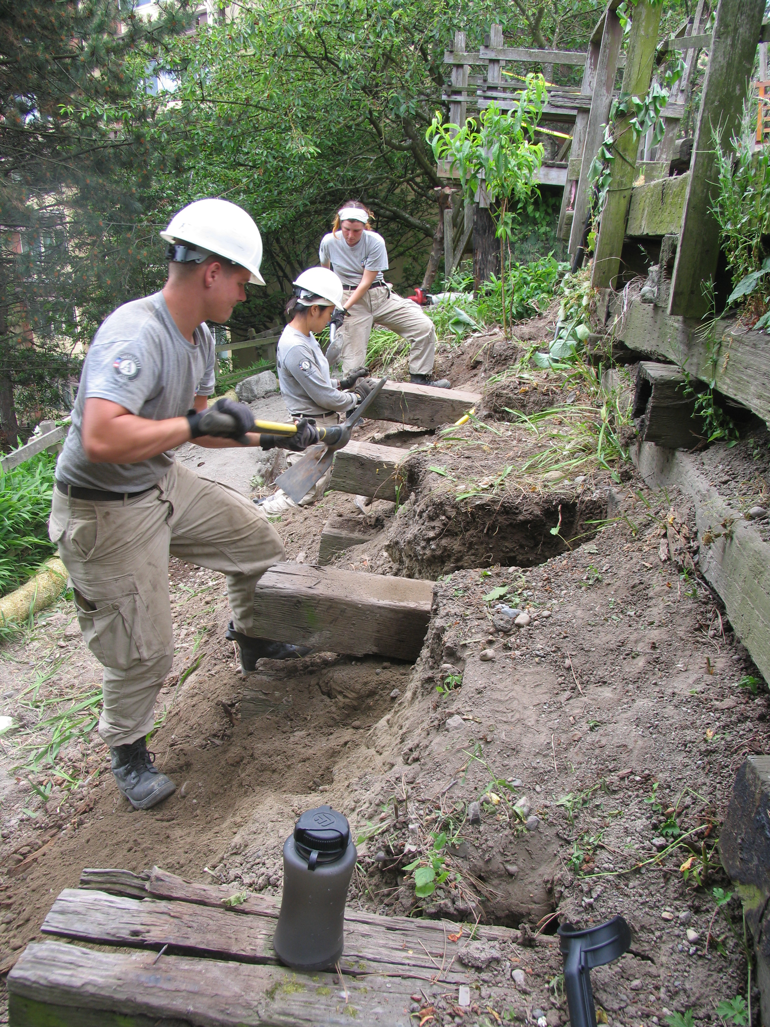 AmeriCorps National Civilian Community Corps Members Remove Old Wall